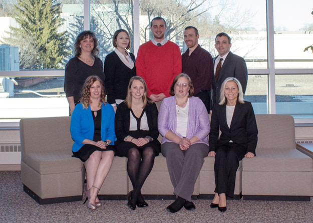 Pictured seated, from left, are inductees Amanda K. Carey, Francesca L. Klinger, Nancy Jean Kopco, and Amanda Marie Zieba.  Pictured standing, from left, is Briget Ford, Coordinator of Part-Time and Graduate Programs and honor society moderator; and inductees Jamie C. Costello, Richard Schofield, Gavin Edward Southworth and Steven Kondracki.