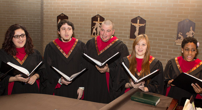 Members of King's College choir, Cantores Christi Regis, rehearse for the annual free public Christmas Concert. Picture from left: Nadia Anabtawi, Ryan O'Donnell, Loe Oley, Kati Sudnick, and Tamika Lee.