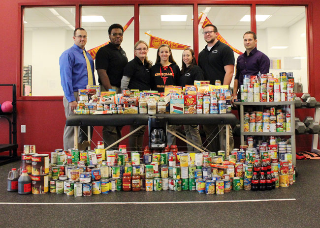 Pictured with the collected items is, from left, Timothy Kulpa, associate clinical professor of athletic training, assistant athletic trainer and Sports Medicine Society co-advisor; Lionel Rice, vice president of the Sports Medicine Society; Allison Gardiner, president; Alyssa Powell, secretary; Caroline Fitch, treasurer; Casey Martin, historian; and, Dr. Jan Kretzschmar, assistant professor of athletic training, director of the exercise science program, and Sports Medicine Society co-advisor.