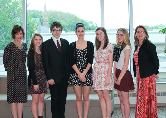 Wallenpaupack Area High School French contest winners who attended the awards dinner at King's College are, standing from left: Barbara Alfano, AATF secretary treasurer and French contest administrator; Wallenpaupack Area High School students Carlie Muehlbauer, Samuel Brady, Bryana Phraner, Haley Gasparine, and Riley Crouthamel; and Renee Schwartz, AATF chapter president. Absent from photo: Mollie Gold, Patricia Ingulli, Katelyn Pelligrino, and Deirdre Schmidt.