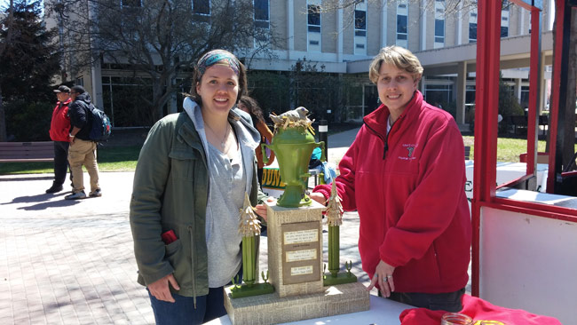 Pictured is Rebecca Taylor, left, a senior Environmental Science major at King's accepting on behalf of the Environmental Club, and Beth DiNardi, Recycling Coordinator for Luzerne County Solid Waste Management Department.  The recycled art trophy was made by local artist Sue Guzik of Hughestown.