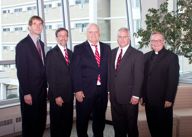 Members of the local legal community participating in the Red Mass at King's College were, pictured from left: Atty. Richard C. Shiptoski, Adjunct Professor, King's College; Judge Joseph M. Cosgrove (Ret.), Deacon John E. O'Connor; Atty. Joseph F. Saporito, Jr., President, Wilkes-Barre Law & Library Association; and Rev. John J. Ryan, C.S.C., President, King's College.