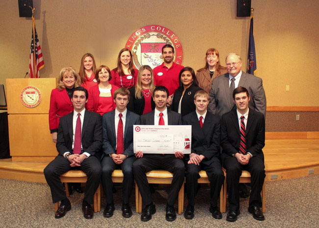 Pictured in front row is the winning team of students who were presented a check for $2,000.  Show, from left, is Thomas Murray, Bennett Williams Michael Brown, Jamie Scarantino, and Anthony Toleno.  Pictured in second row, from left, are King's judges Dr. Joan Blewitt, Theresa Kinney, Korie Munley, Dr. Bindu Vyas, and Dr. Barry Williams. Pictured in third row, from left, are Target representatives Nicole Molino, Katie Gallagher and Nicholas Durham.  Shown at far right of the back row is Dr. Amy Parsons, chair of the King's Marketing Department.
