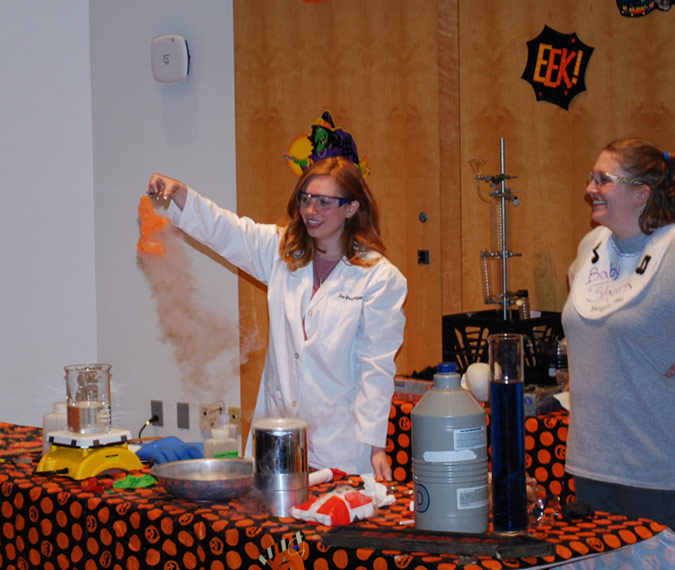 Pictured, from left, is a King's student and Dr. Julie Belanger demonstrating what happens to a balloon animal when it is frozen in liquid nitrogen.