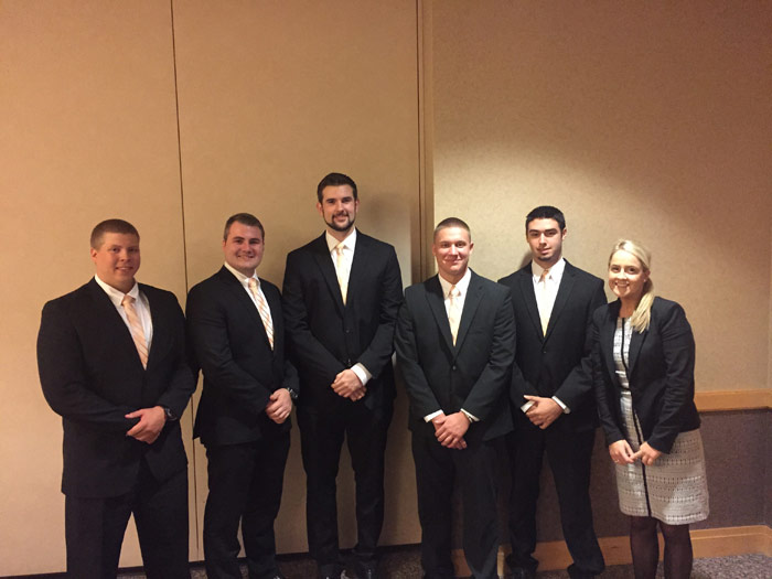 Pictured, from left, are members of the winning team Josh Guilford, Harding; Kyler Kovaleski, Avoca; Mike Prociak, Wilkes-Barre; Zack Hoffman, Dupont; and Carmen Lobrutto, Hughestown.  At far right is Olivia Sinclair, campus recruiter for PwC.