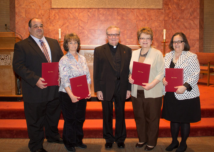 King's College employees honored for 20 years of service were, pictured from left: Raymond Pryor; Gina Dobitas; with Rev. Jack Ryan, C.S.C., president; Eva Guarino; and Dr. Jeanne Torony. Absent from photo: Laurie Ayre.