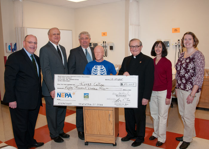 Pictured at recent check presentation are, from left, Bob Morgan, district director for Congressman Matt Cartwright; Tom Pellegrini, vice president for enterprise development for the Northease Pennsylvania Alliance; Gary Baker, director of the Northeast R