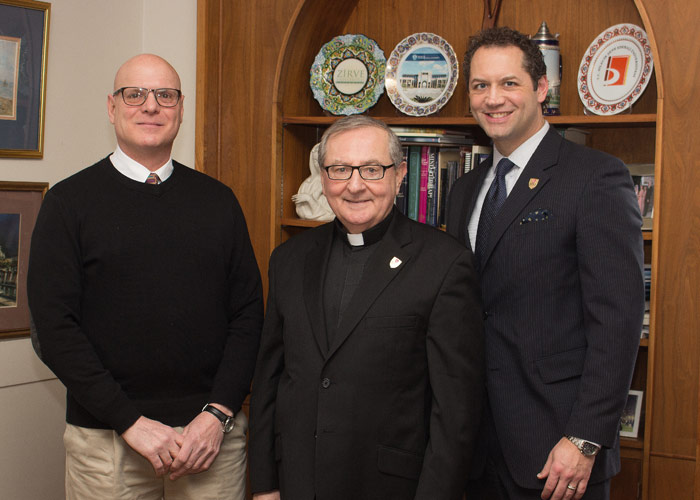 Pictured with DelVecchio is, from left, Father John Ryan, C.S.C., King's president, and Freddie Pettit, vice president for institutional advancement at King's.