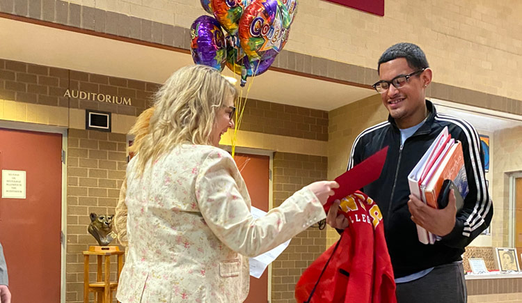 Pictured is Maggie Farrell, associate director of admission at King's, and Presidential recipient, Oscar Gonzalez