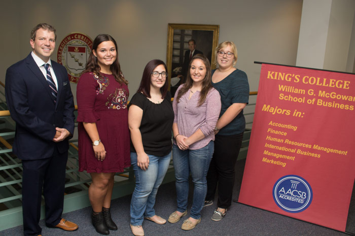 Pictured, from left, is Dr. J.C. Blewitt, assistant professor of management and faculty advisor for the competition; and student team members Adrian Mackiewicz, Samra Jo Fassett, Liz Novak, and Caryn Wielgopolski.