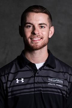 Portrait photo of Cody Lancelotti in a polo shirt.