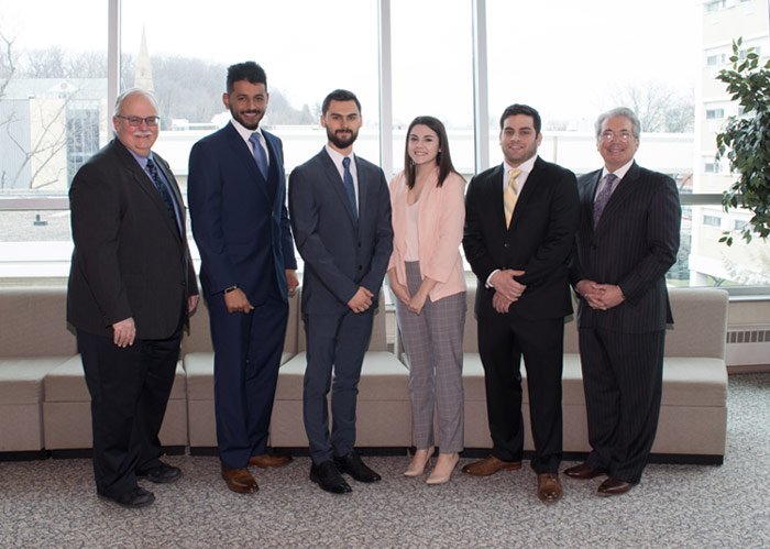 King's College students inducted into MFA national honor society are, pictured from left: Barry Williams, Dean, William G. McGowan School of Business; Turki Altwrqi; Lyle Luckenbill; Marissa Lines; Louis Milillo; and Mark Leffler, FMA Moderator.