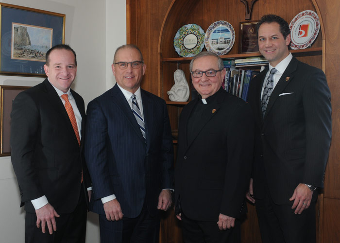 Pictured, from left, is Jim Edwards and Mike Molewski, both principals of CAPTRUST and King's College graduates; and Father John Ryan, C.S.C., president, and Freddie Pettit, vice president for institutional advancement, King's College.