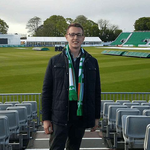 Joshua Frankevich poses in a stadium in Ireland.