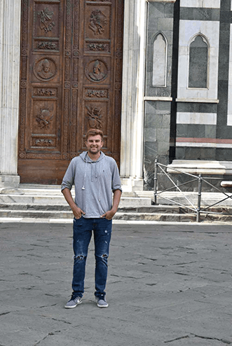 J. Londardi poses for a photo while studying abroad in Italy
