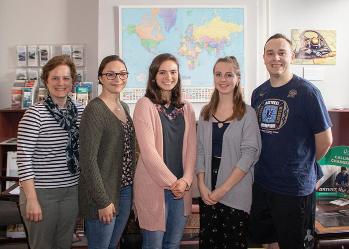 Shown standing, from left, is Margaret Kowalsky, director of the King's Office of Study Abroad; and students Marouchoc, Ritter, Wright, and Kennedy.